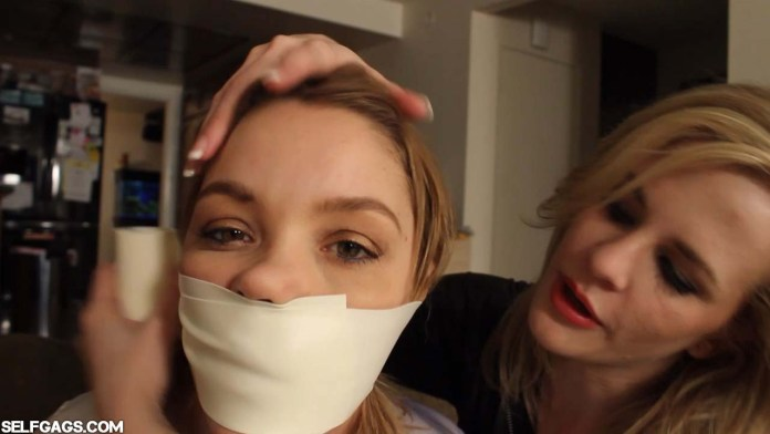 Girl gagged with microfoam tape