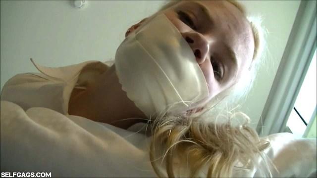 Blonde girl with microfoam tapegag