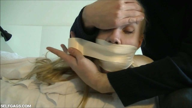 Girl wrap gagged with microfoam tape