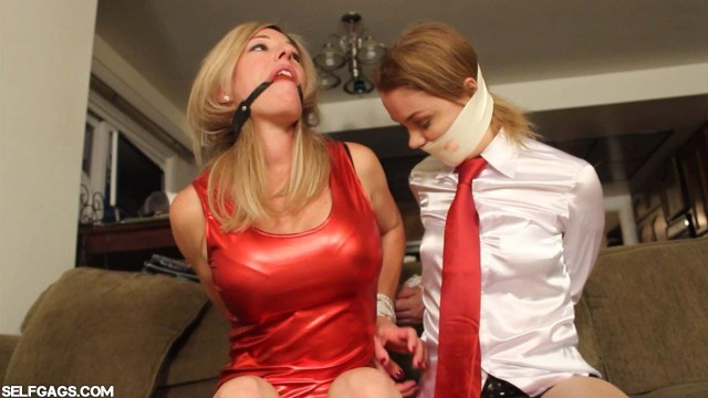 Gagged girl and woman in bondage