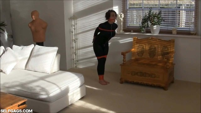 Damsel in distress hopping bound and gagged