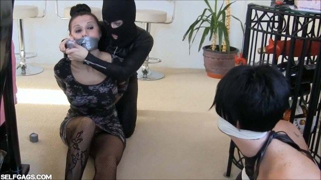 Tape gagged by girl in catsuit