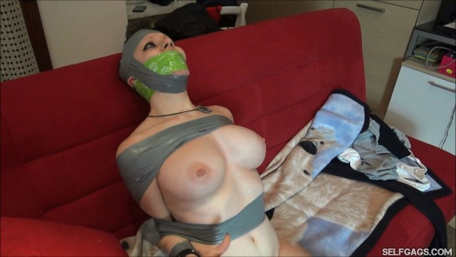 Tape gagged and hooded girl in tight duct tape bondage