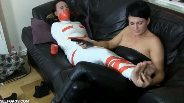 Foot tickling mummifiation bondage