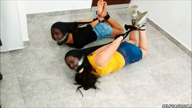Pantyhose hogtied girls in bondage gagged side by side