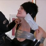 Two sexy women tied up and tape gagged with duct tape by female in leather catsuit