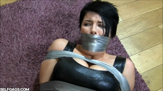 Vengeful wife gets revenge on husband's cheating lover with tight tape bondage