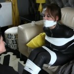 Tape wrap gagged girl in leather catsuit struggles in tape bondage