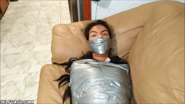 latina girl duct tape mummified and gagged tight