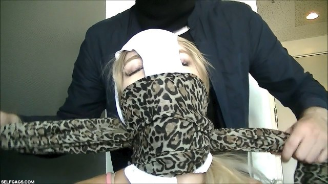 Panty Hooded Girl OTN And OTM Gagged With Sexy Leopard Print Scarf