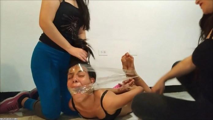 Crying bondage girl hog tied barefoot on the floor
