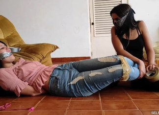 Innocent latina damsel bound and gagged by masked female bandit