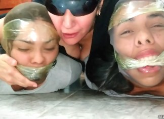 Bound and gagged girls hooded with pantyhose and hogtied by dominant woman for tight bdsm