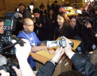Sarah Ryan of Change.org hands over a box of signatures to an Apple Store manager in Grand Central.