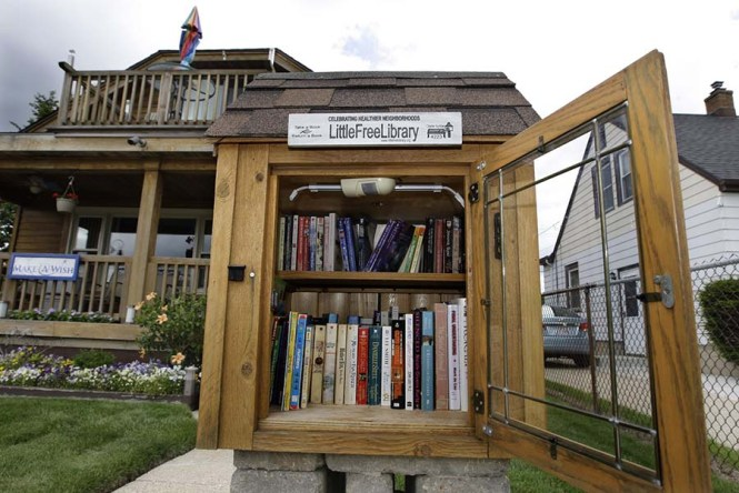 Littlelib27, fea, adp, 2 of 7 - The Little Free Library at the home of Allen Wulk at 1006 E. Howard Ave., Milwaukee, Wi. on Tuesday, July 15, 2014. For story on Little Free Library in local communities. Angela Peterson/apeterson@journalsentinel.com