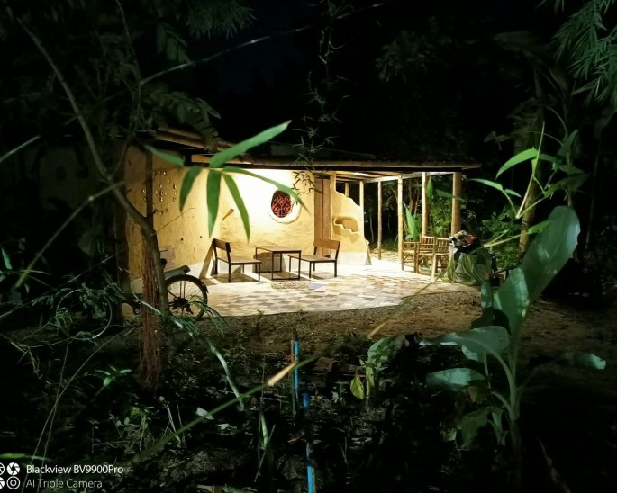 Earthen Building at night with warm light