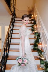 Bride standing on the stairs at the house at Gaie Lea