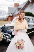 A bride standing by a classic car at Gaie Lea in Staunton, VA