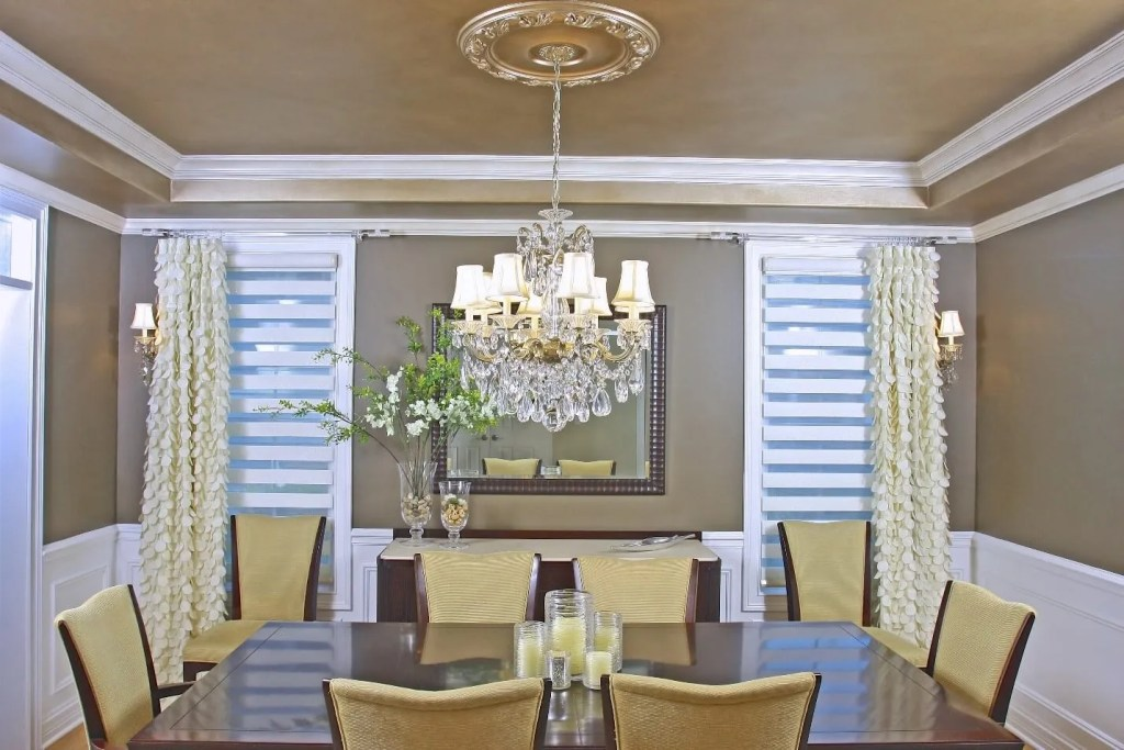 The use of extraordinary fabrics and out-of-the-box ideas create an elegant and whimsical look in this Elmhurst, Illinois dining room. The use of cut-out fabric and acrylic hardware in this contemporary room convey a stylish, artistic sensibility. Incidentally, in the dining room depicted above, there are two air registers on the side of each window; when the air conditioning kicks, in the fabric cut-outs start to flicker like butterflies! What an appetizing view!