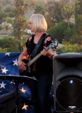 Playing bass on a flatbed truck on the 4th of July with the Mary James Band