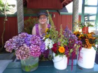 Susan Lenarz arranges flowers outside the front door