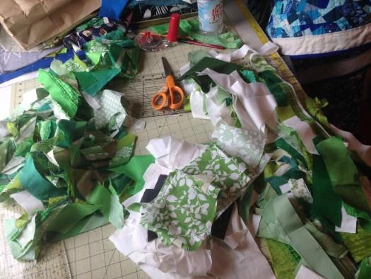 green fabrics on cutting table