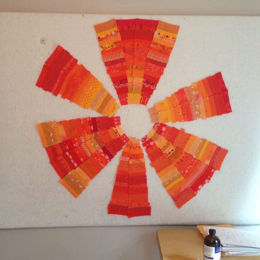 Orange fabric wedges quilt in progress