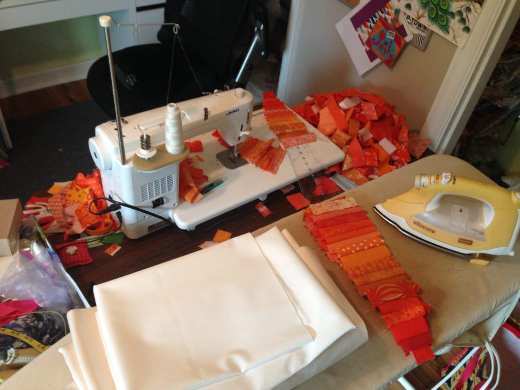 Sewing orange fabric pieces