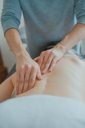 A person receiving a massage on their back.