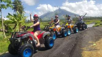 ATV- Mud trail in Albay, behind is the Mayon volcano, dressed with clouds.