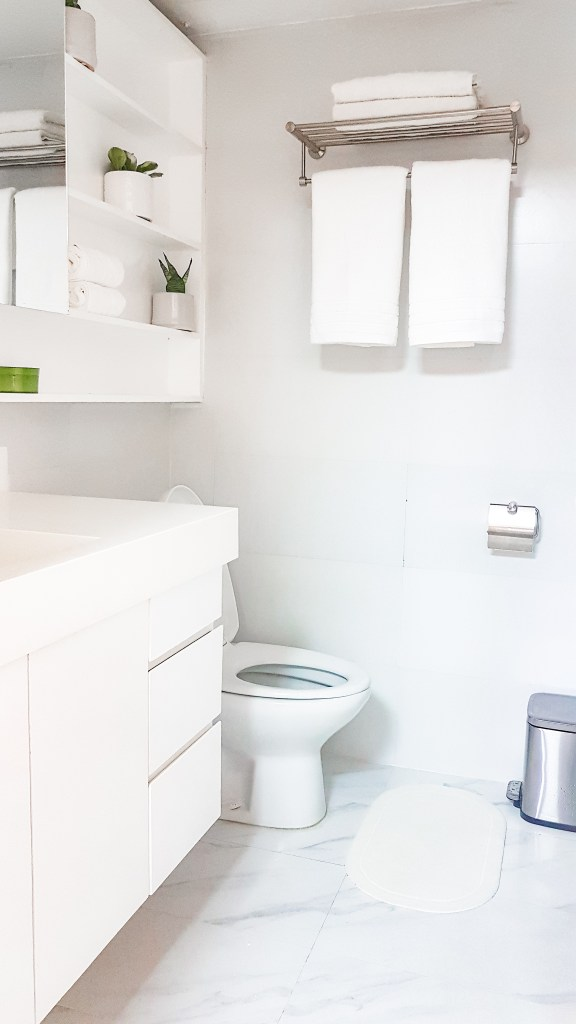 Scandinavian style white bathroom built-in cabinets after condo renovation