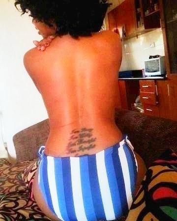 Sheebah showing off her tattoos