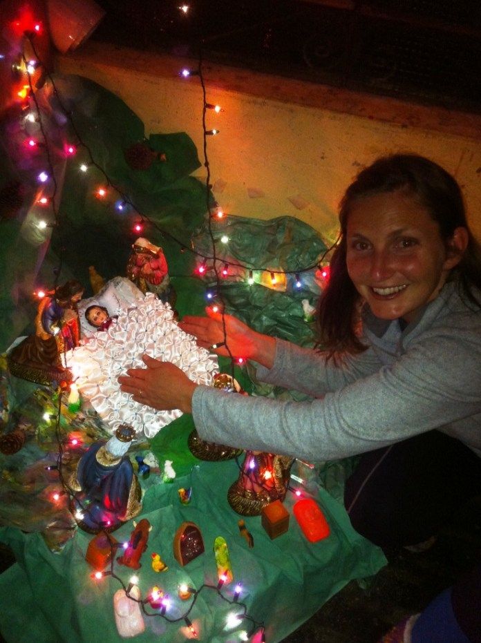 Andrea got to place the baby Jesus in the nacimiento at midnight.