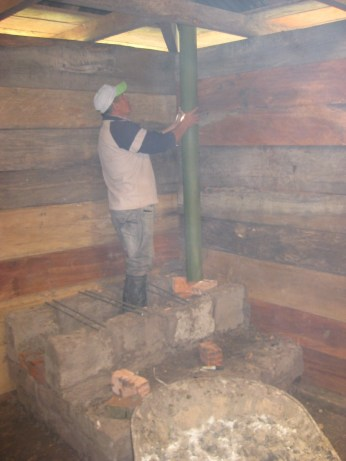 Installing the chimney tube takes patience to make sure it goes in straight. That and a special cement mix with a waterproof additive to put on the roof and make sure rainwater doesn't drip inside the kitchen.