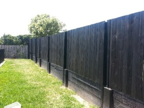 We repaired this fence and rebuilt the retaining wall as part of a small carpentry job