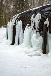 Ice Angel naturally made ice sculpture at the base of a wooden penstock aqueduct on Rice Rips Road in Oakland, Maine.