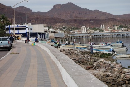 Waterfront road from Marina Seca approaching town, passing a small fishing fleet
