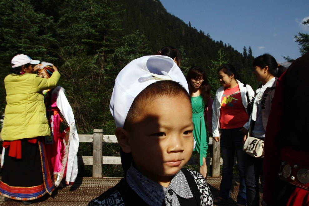 Tourists dressing up in Tibetan dress in the Jiuzhaigou National Park.