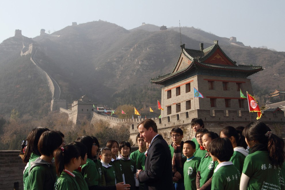 British Prime Minister David Cameron with students on the Great Wall of China. 2010