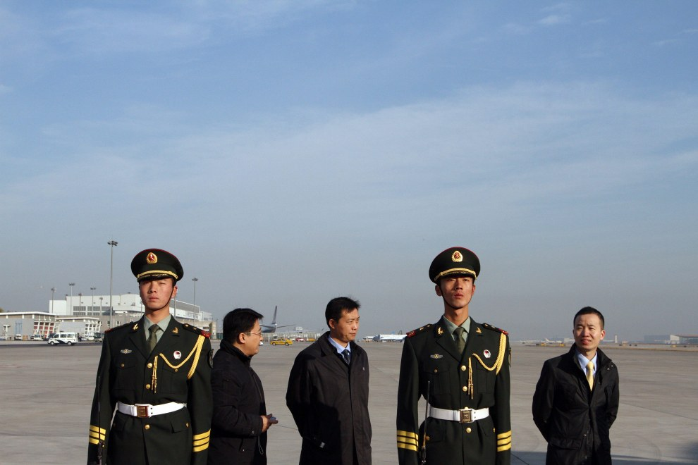 Soldiers and staff await the arrival of British Prime Minister David Cameron on his first trip to China.