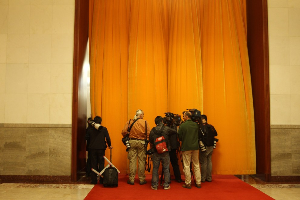 Press photographers in the Great Hall of the People in Beijing, China.