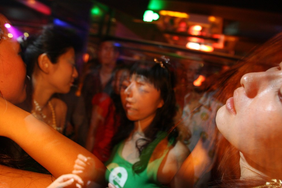 Young Chinese dancing in a nightclub in the Sanlitun district of Beijing.
