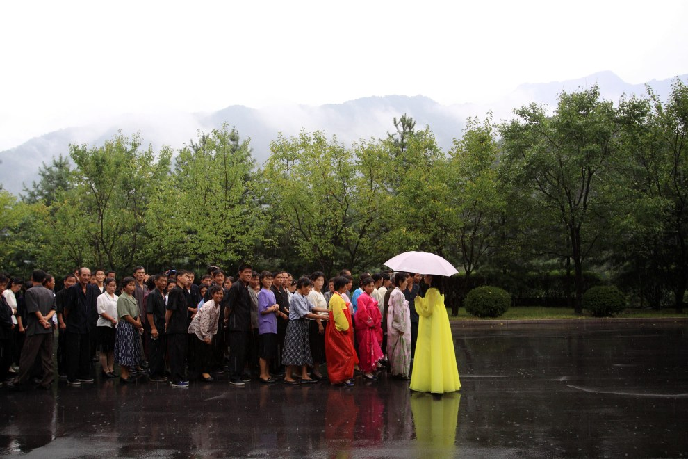 North Koreans queue to enter the 'International Friendship Exhibition' in a city near Pyongyang.