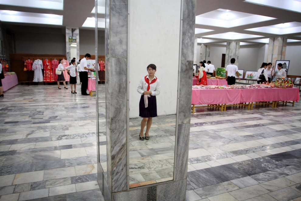 A young girl stands in the hallways of the Mangyongdae Children's Palace, an opulent after-school center for the children of North Korea's elite in Pyongyang.