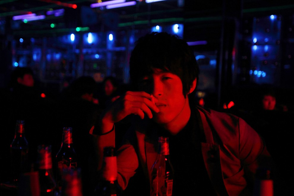 A young man in a nightclub in the town of Yanji, close to the border with North Korea.