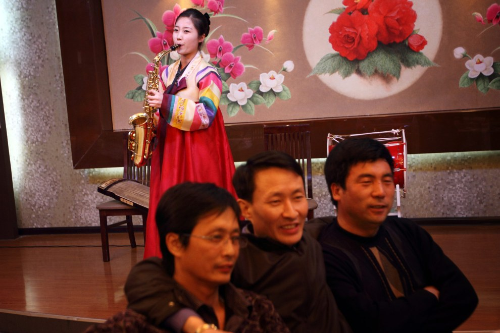 A North Korean woman performs for customers in a restaurant in the town of Yanji, close to the border with North Korea.