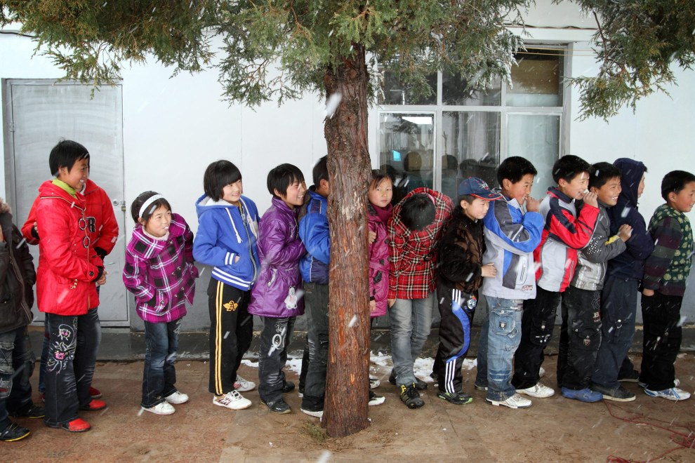 Schoolchildren a village in Inner Mongolia. Roots and Shoots works to educate locals about the importance of planting trees and protecting ecosystems.