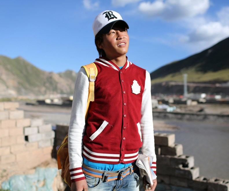 A Tibetan teenager in a relocation village in the Amdo region of the Tibetan Plateau.