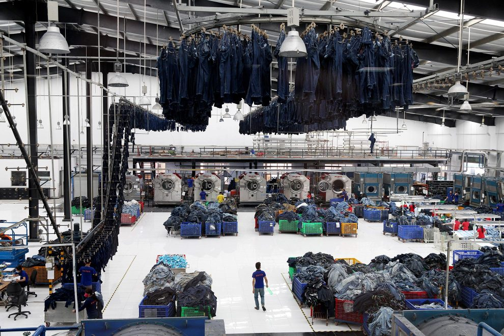 The main production floor at denim detailing company, Sai-Tex, located outside of Ho Chi Minh City. It is using cutting-edge technology and innovative business models to minimize the harmful footprint of textile manufacturing. November, 2014.