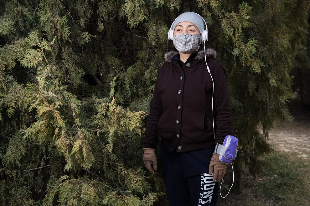 """Drolmaj, an editor with a local publishing company, during her morning walk in central Beijing. """"The pollution makes me sad. I feel sad to live here. When I first came here there was blue sky and white clouds. It's a big problem here."""" PM2.5 reading - 365 - Hazardous"""